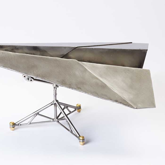 steel paper plane and stand