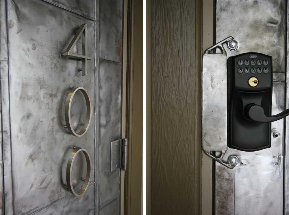 steel encased door with LED illuminated brass lion's head knocker