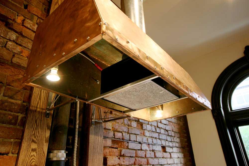 copper and steel range hood